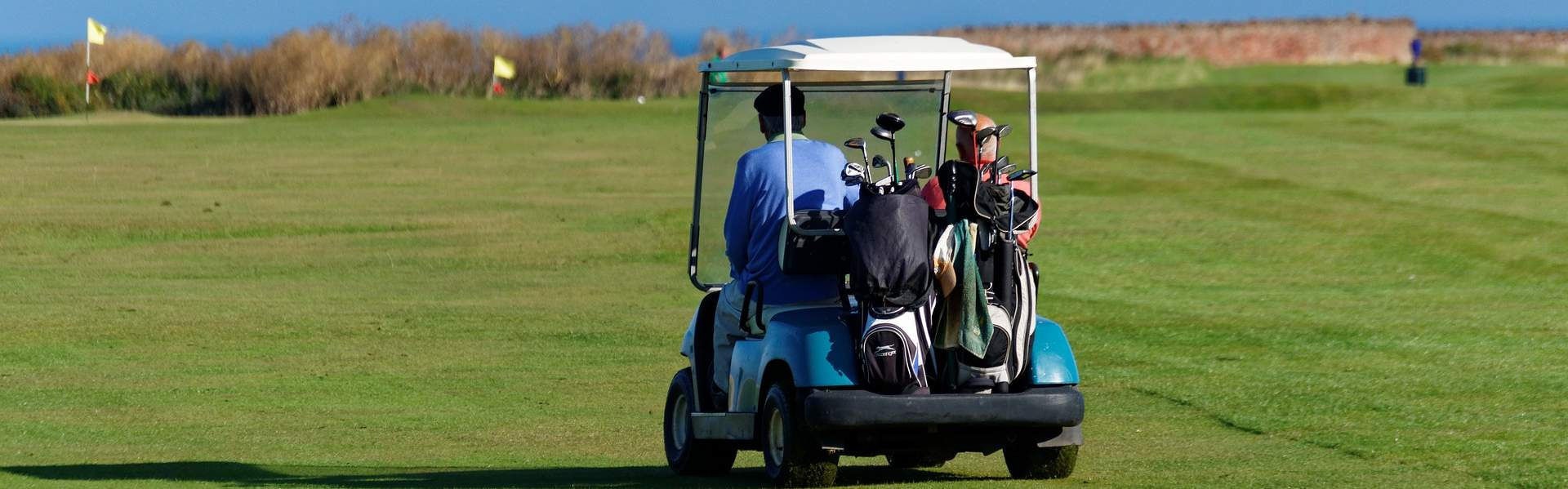Using a golf buggy in St Andrews